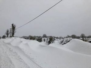 Archerstown road. It's shoulder deep in the drifts. Photo by Rob Clayton.
